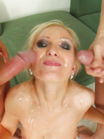 Watch a sensational blonde demonstrating her fisting skills with passion. Her two partners are penetrating her wide holes and covering her face with jizz.