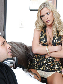 She looks mad while he's just sitting there with his stupid headphones. She really wants someone to drill that leaking pussy on a couch.