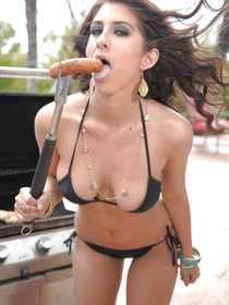 She's subtle and sexy, a perfect combo. Her fascination with sausages was signifying the fact that she wants a huge cock to drill her pussy.