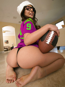 Yeah, who doesn't love football? Go, team, right? This brunette in hipster glasses surprises her boyfriend with her sports knowledge.