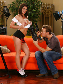 This brunette in white socks can't help but notice his massive camera and now she wants to try fucking while being taped, so they could re-watch the whole thing.