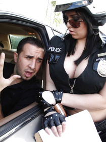 Hot police woman is taking off her black uniform and demonstrating her fuck skills. She is playing with big boner of the handsome prisoner.