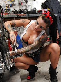 Enter this bald mechanic's garage and see him fucking this busty brunette there. He is falling in passionate love with her big melons.