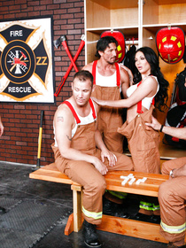 Dirty brunette is practicing wild threesome with two muscular firemen. She is getting presented with double penetration in the locker room.