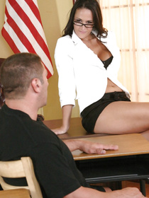 She just spreads her shapely legs on a desk, letting this guy lick her pussy and finger it fro a bit. The action gets even racier after that.