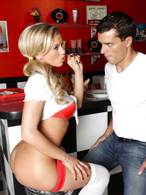 Handsome guy is enjoying passionate closeness with the slutty pornstar in the cafe. He is penetrating her wide ass hole with his erected dick.