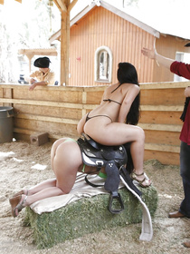 Two filthy brunettes are enjoying hardcore threesome with the strong cowboy wearing the black hat. They are sharing his erected penis wildly.