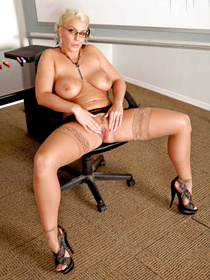Nothing can stop the strong guy banging the chubby blonde wearing lingerie and stockings. He is punishing her so wildly in the office.