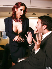 Fucking on a plane is every guy's fantasy, and this dude got real lucky: he fucks a stacked redhead flight attendant for his troubles.