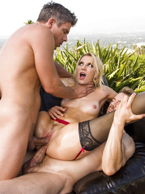Sucking and riding two big boners at the same time is what this lovely blonde is great at. She is enjoying wild threesome on the black sofa outdoor.