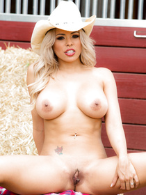 Handsome guy is falling in love with the blonde cowgirl wearing the big hat and denim shorts. She is practicing anal sex with her man outdoor.