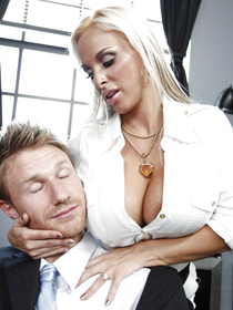 This scene even has some femdom-y elements to it: this blonde bombshell seduces him, grabs him by his tie and he eats her ass.