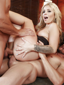 This wavy-haired blonde knows how to get ahead in the corporate world: she decides to fuck two high-powered executives at once.
