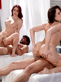 Two sexy long-haired MILF babes decide to visit a massage parlor to have themselves a foursome with two jacked-up masseurs.