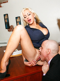 Skirt-wearing blonde almost ruins the meeting by showing her naked tits, but it all works out for her in the end.