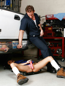 Tanned brunette bombshell Stephanie Cane finds herself fixing a car, realizes that she's a woman and starts dildo-fucking herself.