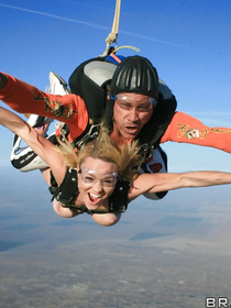 Powerful parachute instructor is banging two wild blondes with passion. He is letting them share his big boner and swallow his jizz.