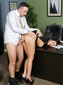Busty brunette in black drops to her knees service her big-dicked boss, but he wants more, he wants to plow that MILF pussy of hers.