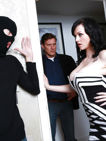 Curly-haired and pale brunette in a corset-like dress gets fucked by a horny burglar with her hubby walking in on them.