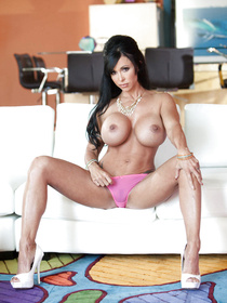 Busty and tanned brunette in pink panties takes off her colorful dress to seduce a guy, he bites the bullet and fucks her senseless.