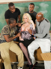 Welcome to the interracial gangbang party this blonde teacher is having in the classroom. She is fucking with two ebony men with excitement.