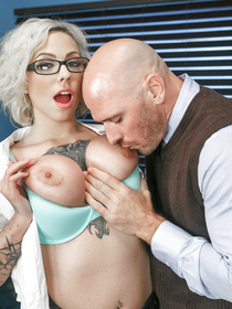 Tattooed blonde wearing school uniform is fucking with the bald teacher. He is kissing her huge melons and fucking her on the table.