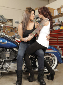 These two babes look great next to a motorbike. They look awesome with wrenches and sex toys, too. So, long story short: the scene is great.