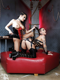 Professional dominatrix professional dominates a beautiful brunette babe. They end up scissoring and eating each other out.