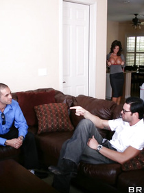 The less you talk about that glorious mullet-like hairdo, the better; enjoy watching a busty brunette get fucked by a big-dicked stud on a couch.