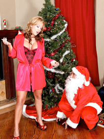 Nikki Sexx walks downstairs, sees Santa and lets him fuck her pussy, not many people can say that they had sex with Father Christmas himself.