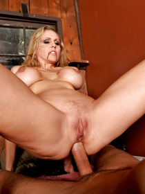 Strong guy is falling in love with the blonde MILF wearing the luxurious red dress. He is penetrating her ass hole and fucking her fake tits.