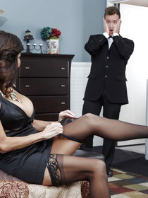 Stockings-clad brunette MILF gets to enjoy a younger stud's cock, since he cannot resist those MILF curves, at all - enjoy the scene.