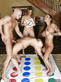 Sweatpants-wearing brunette is hanging out with her girlfriends, they spin the bottle and play twister. End up fucking this hung stud.