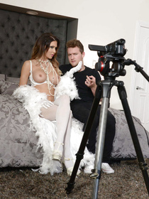 Hardcore home movie: brunette rocks her hottest white get-up, it's pretty peacock-y, she also sets up a camera and gets fucked by her stud.