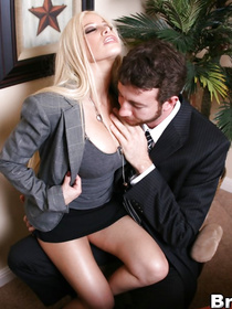 Strong man is banging the juicy blonde in the office. She is taking off her sexy skirt and playing wild games with his cock on the table.