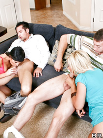 Wonderful ladies are having passionate sex with their men on the big blue sofa. They are all feeling so great enjoying this swinger party.