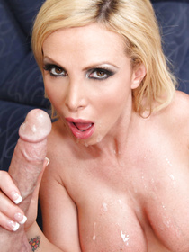 Big-dicked dude kicks in the door, charges this MILF blonde with something and ends up fucking her tight mature pussy on a couch.