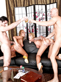 Two passionate couples are having dinner and enjoying wild group sex party. The busty blondes are being fucked by their men on the black sofa.