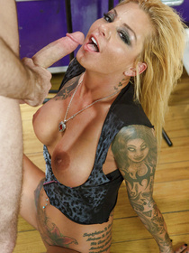 Tatted-up blonde with incredibly trashy look gets fucked by a big-dicked guy, in the ass. Because she loves anal pounding.
