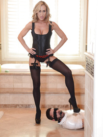 Juicy blonde wearing black stockings and the corset is fucking wildly with the strong actor. She is also giving him unforgettable blowjob.