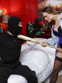 Horny woman is playing dirty games with the strong man in the black mask. She is being fucked by him while her husband is sleeping in the bed.