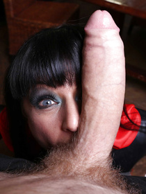 Nothing can stop the strong guy banging this juicy MILF wearing black leather clothes and glasses. He is drilling her twat with his massive cock.