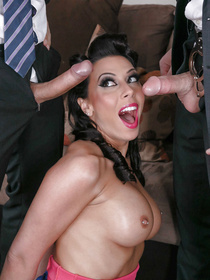 Rachel Starr looks like your typical housewife from the 60s, she happily meets to cops and decides to get spit-roasted by them.