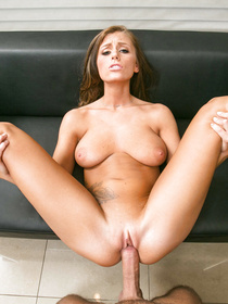 Playing with her boyfriend's giant boner is what this brunette is fond of. She is getting fucked and giving deep blowjob on the black sofa.