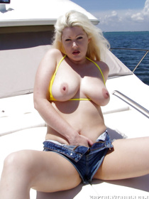 Check out a sexy pickup story of a stunning blonde on the beach, who gets seduced by a rich captain to fuck on his luxury yacht.