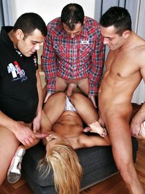 Three busty guys are making this European blonde really happy. They are presenting her with the hottest threesome in her life.