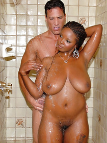Lustful ebony mademoiselle is taking shower with her white lover. She is sucking his strong penis and getting her wet pussy banged deep.