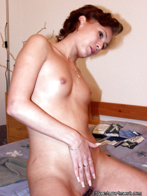 Wonderful MILF having short hair is demonstrating her awesome masturbation skills on camera. She is presenting herself with great emotions.