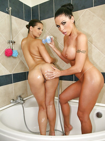 Lovely lesbians are enjoying passionate closeness in the bathroom. They are also drilling each other's holes with big dildo in bedroom.