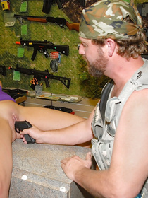 Slutty woman in purple dress wants to buy a big gun. The shop assistant demonstrates her his cock and she lets him bang her hard.
